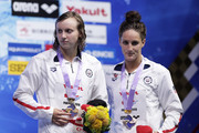 Gold medalist Katie Ledecky (L) of the United States and bronze medalist Leah Smith of the United States celebrate on the podium at the medal ceremony for the Women's 1500m Freestyle Timed-Final on day four of the Pan Pacific Swimming Championships at Tokyo Tatsumi International Swimming Center on August 12, 2018 in Tokyo, Japan.