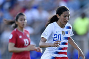 Christen Press #20 of the USA dribbles past Onelys Alvarado #13 of Panama on her way to scoring a goal during the soccer game at WakeMed Soccer Park on October 7, 2018 in Cary, North Carolina.