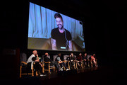 "Ricky Martin video calls in as Ryan Murphy, Brad Simpson, Tom Rob Smith, Darren Criss, Edgar Ramirez, Finn Wittrock, and Alexis Martin Woodall attend the panel and photo call for FX's ""The Assassination of Gianni Versace: American Crime Story"" at Los Angeles County Museum of Art on August 15, 2018 in Los Angeles, California."
