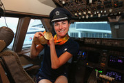 Sarah Storey of the Paralympics GB Team shows her medals in the flight deck they prepare to fly back from Galeao Airport on British Airways flight BA2016 to Heathrow Airport on September 19, 2016 in Rio de Janeiro, Brazil.