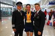 Sarah Storey of the Paralympics GB Team talks with British Airways cabin crew prior to flying back from Galeao Airport on British Airways flight BA2016 to Heathrow Airport on September 19, 2016 in Rio de Janeiro, Brazil.