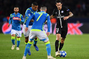 Angel Di Maria of Paris Saint-Germain in action while under pressure during the Group C match of the UEFA Champions League between Paris Saint-Germain and SSC Napoli at Parc des Princes on October 24, 2018 in Paris, France.