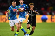 Neymar of Paris Saint-Germain is challenged by Marek Hamsik of Napoli  during the Group C match of the UEFA Champions League between Paris Saint-Germain and SSC Napoli at Parc des Princes on October 24, 2018 in Paris, France.