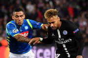Neymar of Paris Saint-Germain and Allan of Napoli during the Group C match of the UEFA Champions League between Paris Saint-Germain and SSC Napoli at Parc des Princes on October 24, 2018 in Paris, France.