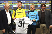 (L-R) Vorwerk Folletto President Patrizio Barsotti, new signing Andrea Coda, Parma FC manager Roberto Donadoni and General Manager of Parma Pietro Leonardi during a press conference at the club's training ground on January 26, 2013 in Collecchio, Italy.
