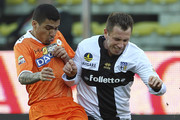 Antonio Cassano (R) of Parma FC competes for the ball with Marques Loureiro Allan (L) of Udinese Calcio during the Serie A match between Parma FC and Udinese Calcio at Stadio Ennio Tardini on January 26, 2014 in Parma, Italy.