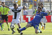 Marco Marchionni of Parma FC competes for the ball with Andrea Lazzari of Udinese Calcio during the Serie A match between Parma FC and Udinese Calcio at Stadio Ennio Tardini on April 14, 2013 in Parma, Italy.