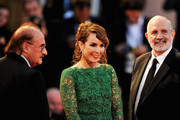 "(L-R) Composer Pino Donaggio with actress Noomi Rapace and director Brian de Palma attend the ""Passion"" Premiere during the 69th Venice Film Festival at the Palazzo del Casino on September 7, 2012 in Venice, Italy."