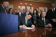 Speaker of the House Paul Ryan (R-WI) signs H.R. 2810, the National Defense Authorization Act, with members of the House Armed Services Committee, including Chairman Mac Thornberry (R-TX) (3rd R) during an enrollment ceremony in the speaker's office at the U.S. Capitol November 30, 2017 in Washington, DC. The $696 billion defense bill exceeds President Donald Trump's budget request and breaks through earlier caps on national defense spending.