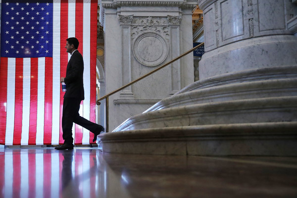 News Pictures Of The Week - December 20 [news pictures of the week,red,blue,column,flag,standing,architecture,stairs,reflection,photography,floor,speaker,paul ryan,r,tax cut,deficit,wi,great hall,house of representatives,farewell address]