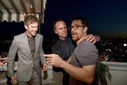 (L-R) Dan Stevens, Walton Goggins, and Sam Rockwell attend Paul Smith's intimate dinner with Gary Oldman at Chateau Marmont on April 10, 2018 in Los Angeles, California.