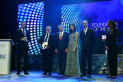 Pascal Torres (2L) Secretary of the UEFA Foundation for Children is presented with the Award for Foundation of the Year by Joel Bouzou, President and Founder of Peace & Sport (3L), Yelena Isinbayeva (3R) and Denis Masseglia, President of the French National Olympic Committee (2R) during the Peace & Sport Gala Dinner at the Sporting Club on November 26, 2015 in Monaco, Monaco.