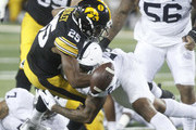 IOWA CITY, IOWA- SEPTEMBER 23:  Running back Akrum Wadley #25 of the Iowa Hawkeyes fumbles the ball as he is hit in the third quarterby safety Marcus Allen #2 of the Penn State Nittany Lions on September 23, 2017 at Kinnick Stadium in Iowa City, Iowa.