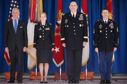 (L-R) Army Secretary John McHugh, Chief Warrant Officer Five Debra Blankenbaker, Army Chief of Staff General Raymond Odierno and Sergeant Major of the Army Daniel Dailey participate in a commencement ceremony for the U.S. Army's annual observance of Sexual Assault Awareness and Prevention Month in the Pentagon Center Courtyard March 31, 2015 in Arlington, Virginia. Blankenbaker was presented with the Department of Defense Sexual Assault Prevention Innovation Award for her work with the 7th Civil Support Command. In conjunction with the national campaign against sexual assault, The Army announced this year's theme, 'Not in My Squad. Not in Our Army. We are Trusted Professionals,' during the ceremony.