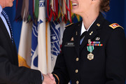 Army Secretary John McHugh (L) congratulates Captain Nicole Myers during a commencement ceremony for the U.S. Army's annual observance of Sexual Assault Awareness and Prevention Month in the Pentagon Center Courtyard March 31, 2015 in Arlington, Virginia. Myers was awarded the Army Sexual Assault Response Coordinator of the Year for her work in the Sexual Harassment/Assault Response and Prevention (SHARP) Program Office at Fort Irwin. In conjunction with the national campaign against sexual assault, The Army announced this year's theme, 'Not in My Squad. Not in Our Army. We are Trusted Professionals,' during the ceremony.