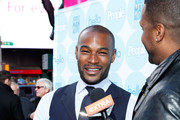 """Model Tyson Beckford (L) and TV Personality A. J. Calloway attend People Celebrates Iconic """"Sexiest Man Alive"""" Issue in Times Square on November 20, 2013 in New York City."""