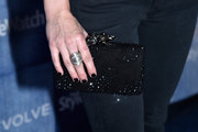 Actress Heather McComb (clutch detail) attends the People StyleWatch Denim Event at The Line on September 18, 2014 in Los Angeles, California.