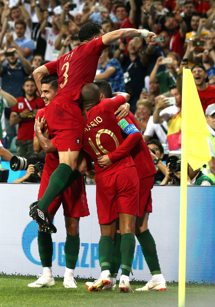 Portugal Vs. Spain: Group B - 2018 FIFA World Cup Russia [player,sports,football player,team sport,sport venue,soccer player,product,ball game,team,tournament,cristiano ronaldo,teammates,goal,portugal,russia,fisht stadium,team,spain: group b - 2018 fifa world cup,2018 fifa world cup,group b match]