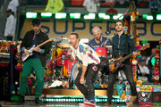 (L-R) Jonny Buckland, Chris Martin, Will Champion and Guy Berryman of Coldplay perform onstage during the Pepsi Super Bowl 50 Halftime Show at Levi's Stadium on February 7, 2016 in Santa Clara, California.