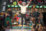 Jonny Buckland, Chris Martin, Guy Berryman and Will Champion of Coldplay perform onstage during the Pepsi Super Bowl 50 Halftime Show at Levi's Stadium on February 7, 2016 in Santa Clara, California.