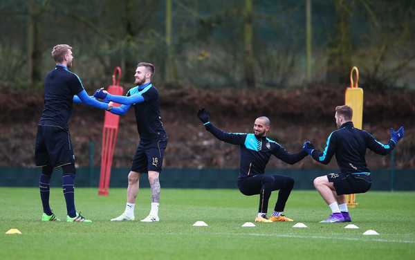 Arsenal FC Training Session & Press Conference [sports,player,team sport,ball game,team,soccer,competition event,sports equipment,sports training,tournament,aaron ramsey,per mertesacker,theo walcott,united kingdom,st albans,arsenal fc training session press conference,arsenal,uefa champions league,training session,match]