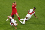 Yoshimar Yotun and Renato Tapia of Peru challenge Christian Eriksen of Denmark during the 2018 FIFA World Cup Russia group C match between Peru and Denmark at Mordovia Arena on June 16, 2018 in Saransk, Russia.