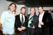 (EXCLUSIVE ACCESS, SPECIAL RATES APPLY) (L-R) Photgraphers Dimitrios Kambouris, Jamie McCarthy, Patrick McMullan and Dave Kotinsky attend a pet portrait exhibition by Getty Images staff photographer Jamie McCarthy to benefit Animal Care & Control of NYC at the Empire Hotel on December 17, 2014 in New York City.