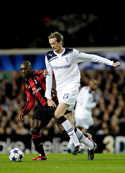 Peter Crouch Clarence Seedorf of Milan battles for the ball with Peter Crouch of Tottenham during the UEFA Champions League round of 16 second leg match between Tottenham Hotspur and AC Milan at White Hart Lane on March 9, 2011 in London, England.