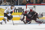 Scott Smith #35 of the Peterborough Petes stops Mitchell Marner #93 of the London Knights in an OHL game at Budweiser Gardens on December 14, 2014 in London, Ontario, Canada. The Knights defeated the Petes 5-2.