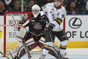Scott Smith #35 of the Peterborough Petes tries to look past a screening Mat Rupert #46 of the London Knights in an OHL game at Budweiser Gardens on December 14, 2014 in London, Ontario, Canada. The Knights defeated the Petes 5-2.