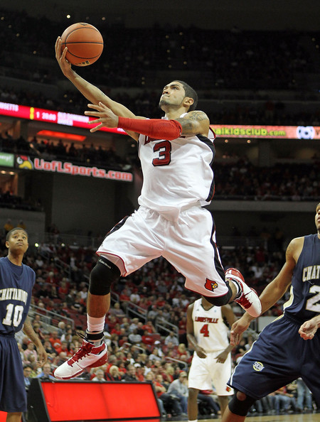 Peyton Siva Peyton Siva #3 of the Louisville Cardinals shoots the ball during the game against  Chattanooga Mocs at the KFC Yum! CENTER on November 22, 2010 in Louisville, Kentucky.  Louisville won 106-65.