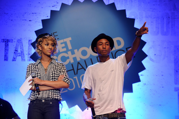 "Pharrell Williams Singer Keri Hilson and recording artist Pharrell Williams speak onstage at ""The Get Schooled National Challenge & Tour"" at Martin Luther King High School on September 24, 2010 in New York City."
