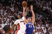 Ersan Ilyasova #23 of the Philadelphia 76ers shoots the ball over James Johnson #16 of the Miami Heat in the first quarter during Game Four of Round One of the 2018 NBA Playoffs at American Airlines Arena on April 21, 2018 in Miami, Florida. NOTE TO USER: User expressly acknowledges and agrees that, by downloading and or using this photograph, User is consenting to the terms and conditions of the Getty Images License Agreement.