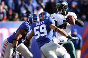 Michael Vick and Justin Tuck Photos Photo