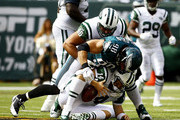 Connor Barwin #98 of the Philadelphia Eagles sacks  Ryan Fitzpatrick #14 of the New York Jets in the second quarter at MetLife Stadium on September 27, 2015 in East Rutherford, New Jersey.