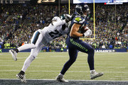 Tight end Jimmy Graham #88 of the Seattle Seahawks makes an 11 yard touchdown catch against safety Malcolm Jenkins #27 of the Philadelphia Eagles in the first quarter at CenturyLink Field on December 3, 2017 in Seattle, Washington.