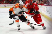 Andrew MacDonald #47 of the Philadelphia Flyers battles with Frans Nielsen #51 of the Detroit Red Wings during the second period at Little Caesars Arena on January 23, 2018 in Detroit, Michigan.
