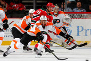 Pierre-Edouard Bellemare #78 of the Philadelphia Flyers clears the puck before Jacob Josefson #16 of the New Jersey Devils can get to it in the first period on February 16, 2016 at Prudential Center in Newark, New Jersey.