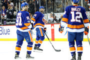 Johnny Boychuk #55, John Tavares #91 and Josh Bailey #12 of the New York Islanders celebrate after scoring a goal in the second period agianst the Philadelphia Flyers during their game at Barclays Center on November 22, 2017 in the Brooklyn borough of New York City.