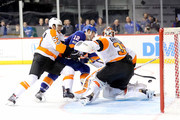 Josh Bailey #12 of the New York Islanders scores the game winning goal against Shayne Gostisbehere #53 and Brian Elliott #37 of the Philadelphia Flyers in overtime during their game at Barclays Center on November 22, 2017 in the Brooklyn borough of New York City.