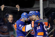 Josh Bailey #12 (middle) celebrates with teammates Nick Leddy #2 and John Tavares #91 of the New York Islanders after scoring the game winning goal against the Philadelphia Flyers during their game at Barclays Center on November 22, 2017 in the Brooklyn borough of New York City.