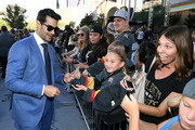 Max Pacioretty #67 of the Vegas Golden Knights signs autographs for fans as he arrives at the team's home opener against the Philadelphia Flyers at T-Mobile Arena on October 04, 2018 in Las Vegas, Nevada.