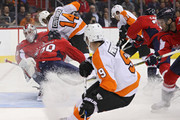 Goalie Braden Holtby #70 of the Washington Capitals collides with teammates Christian Djoos #29 against the Philadelphia Flyers during the first period at Capital One Arena on December 31, 2018 in Washington, DC.