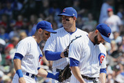 Tommy La Stella #2 (L) and Anthony Rizzo #44 of the Chicago Cubs try to give encouragement to starting pitcher Tyler Chatwood #21 before Chatwood is removed from the game in the 5th inning against the Philadelphia Phillies at Wrigley Field on June 7, 2018 in Chicago, Illinois.