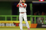 Andres Blanco #4 of the Philadelphia Phillies reacts after hitting a double during the eighth inning of a game against the Miami Marlins at Marlins Park on May 7, 2016 in Miami, Florida.