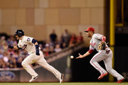 Andres Blanco #4 of the Philadelphia Phillies gives chase as Brian Dozier #2 of the Minnesota Twins is caught in a rundown between second and third base during the third inning of the game on June 22, 2016 at Target Field in Minneapolis, Minnesota.