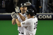 (L-R) Derek Jeter #2 and Johnny Damon #18 of the New York Yankees celebrate after they scored on a 2-run single by Hideki Matsui #55 in the bottom of the third inning against the Philadelphia Phillies in Game Six of the 2009 MLB World Series at Yankee Stadium on November 4, 2009 in the Bronx borough of New York City.