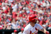 Greg Garcia #35 of the St. Louis Cardinals follows through on a RBI single during the fourth inning against the Philadelphia Phillies at Busch Stadium on May 20, 2018 in St. Louis, Missouri.