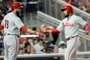 Andres Blanco #4 of the Philadelphia Phillies celebrates with Darin Ruf #18 after scoring the game winning run in the seventh inning against the Washington Nationals at Nationals Park on April 26, 2016 in Washington, DC. Philadelphia won the game 4-3.