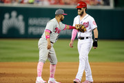 Bryce Harper #34 of the Washington Nationals is tagged out by Andres Blanco #4 of the Philadelphia Phillies in the fifth inning at Nationals Park on May 14, 2017 in Washington, DC. Players are wearing pink to celebrate Mother's Day weekend and support breast cancer awareness.